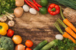 Various fresh vegetables on a wooden table. Top view. - 193412963