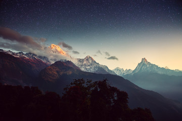 Night landscape on early morning. Starry sky with over the mountains.
