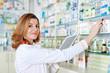Leinwanddruck Bild - Pharmacist with tablet and drug
