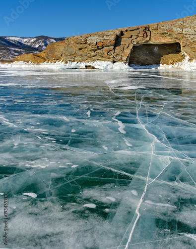 Russia. The unique beauty of transparent ice of lake Baikal. - 193435707