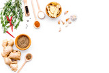 Seasoning background. Dry spices near ginger, garlic, rosemary, chili on white background top view copy space - 193444752