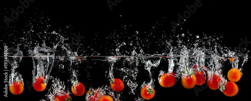 group of tomatoes in water splash