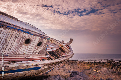 Foto op Aluminium Schipbreuk Shipwreck at the coastline of a small cretan fishing village. Once upon the time it was sailing to the aegean sea.