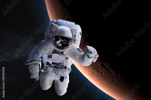 Tuinposter Heelal Astronaut in outer space on background of the Mars. Elements of this image furnished by NASA.