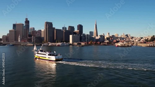 Foto op Aluminium New York Ship Traveling by San Francisco Skyline by Aerial Drone