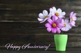 Happy Anniversary card with flowers in the vase