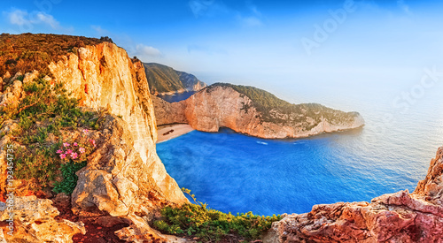 Foto op Aluminium Schipbreuk Greece. Epic sunset scenery of Zate island, full name is Zakynthos - popular summer resort and European travel destination in Greece. Picturesque Navagio beach panorama with shipwreck landmark.