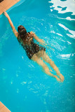 Woman floating relaxing in swimming pool water. - 193467791
