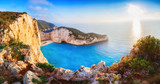 Greece. Epic sunset scenery of Zate island, full name is Zakynthos - popular summer resort and European travel destination in Greece. Picturesque Navagio beach panorama with shipwreck landmark.  - 193475378