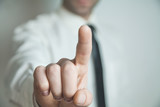 Businessman pointing finger.