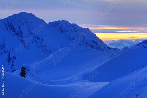 Aluminium Donkerblauw Snow covered mountains in the Transylvanian Alps, Romania, Europe