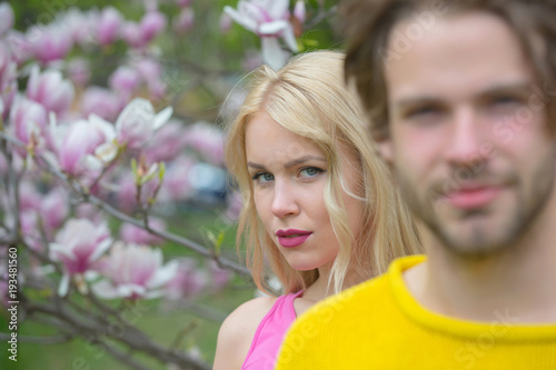 Fototapeta magnolia, couple in love in spring flower blossom