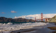 Golden Gate bridge on a sunny day with a blue sky and white clouds, San Francisco, California
