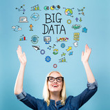 Big Data with young woman reaching and looking upwards - 193511327