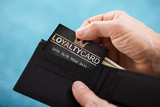 Person Removing Loyalty Card From Wallet - 193522347