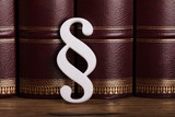 Paragraph Symbol Leaning On Law Books