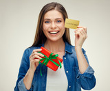 Smiling woman holding credit card and gift box. - 193539731