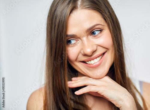 Smiling woman show healthy teeth.