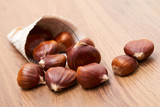 edible chestnut on the table - 193542305
