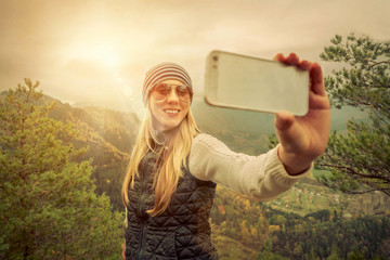 Young woman selfie on the beautiful nature view in mountains.