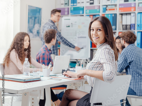 Young business team and girl smiling