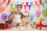 Young man with a labrador retriever celebrating a birthday