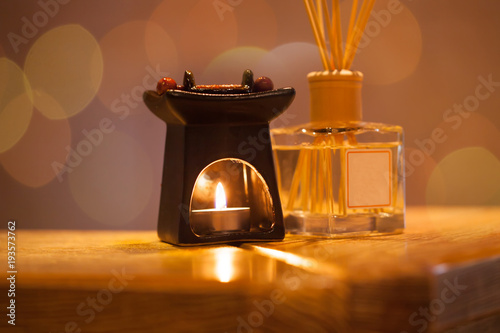 Burning candles and pebbles for aromatherapy session © Svetoslav Sokolov