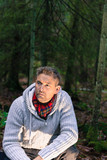 Mid adult man in woods lifestyle portrait wearing knitted jumper and red scarf looking away - 193579929
