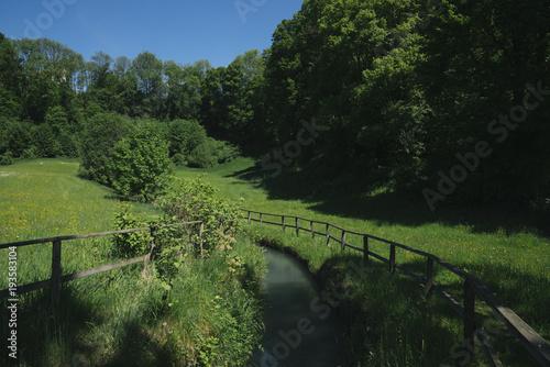 Aluminium Lente A river in spring landscape