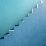 Blue stairs and wall abstract background