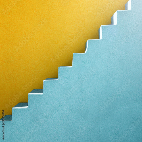 blue stairs and yellow wall background