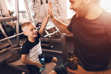 Father and son in the gym. Father and son spend time together and lead a healthy lifestyle. - 193607503