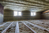 House attic under construction. Mansard walls and ceiling insulation with rock wool. Fiberglass insulation material in wooden frame for cold barrier - 193609154