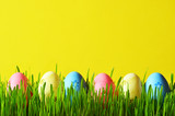 Painted Easter eggs in a green grass on a meadow. - 193610165