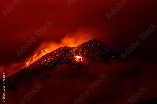 Foto op Canvas Rood paars Volcano eruption landscape at night - Mount Etna in Sicily