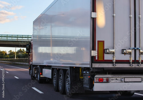 Fototapeta Truck with semitrailer moves along the road.