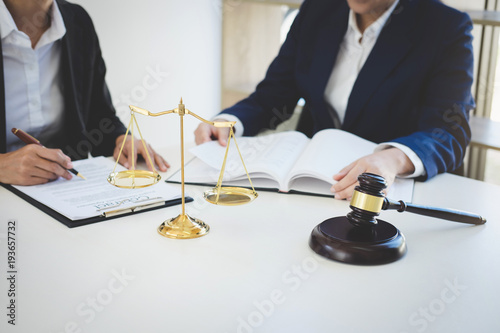 Teamwork of business lawyer colleagues, consultation and conference of professional female lawyers working having at law firm in office. Concepts of law, Judge gavel with scales of justice