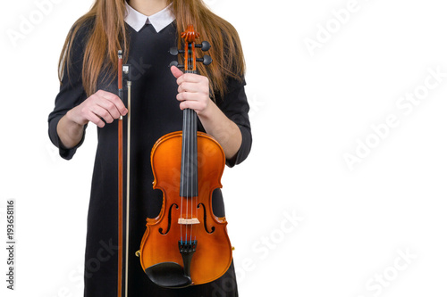 Fototapeta girls with violins stand in a row