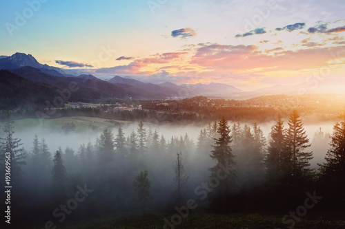 misty sunset over the mountains - 193669563