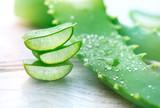 Aloe Vera closeup. Sliced Aloevera natural organic renewal cosmetics, alternative medicine. Organic skincare concept. On white wooden background - 193675777