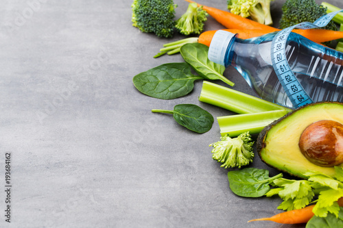 Fototapeta Fresh healthy vegetables, water. Health, sport and diet concept.