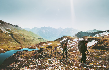 Couple backpackers hiking together in mountains adventure travel lifestyle wanderlust concept active vacations outdoor