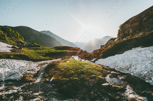 Morning sun light over river in mountains spring Landscape Travel wild nature