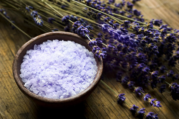 Lavender bath salt in wood bowl and lavender plant with purple flowers like wellness and spa concep  © starblue