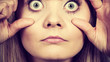 Woman having weirdly wide open eyes