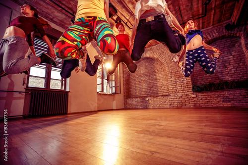 modern dancing group practice dancing in jump