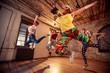 Leinwanddruck Bild - Group of modern dancer jumping during music