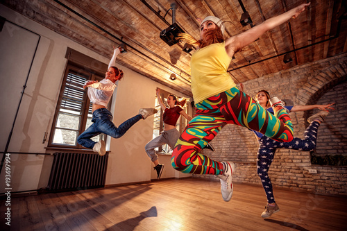 Group of modern dancer jumping during music