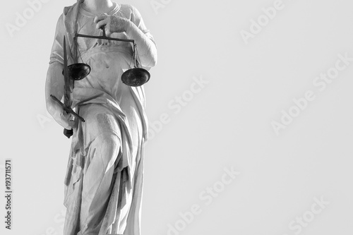 statue of justice with sword and scales, legal law concept (black and white effect)