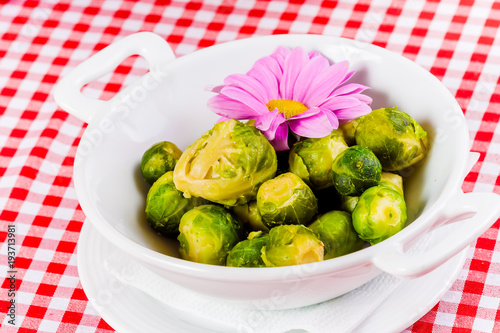 Fotobehang Brussel Boiled brussels sprouts in white bowl. Close up